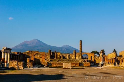 Mount Vesuvius behind the ruins of the main square in Pompeii.