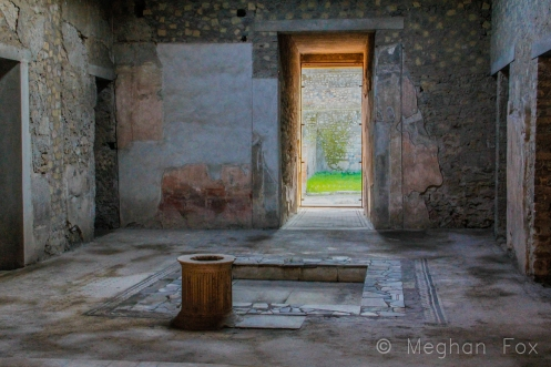 the foyer of a wealthy Roman family's home, featuring the trademark entrance corridor leading to the rainwater-collecting fountain.