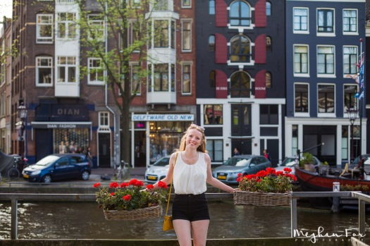 flowers, bright buildings, and a canal = Amsterdam